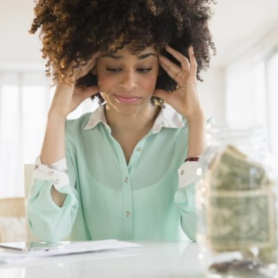 woman is stressed about money